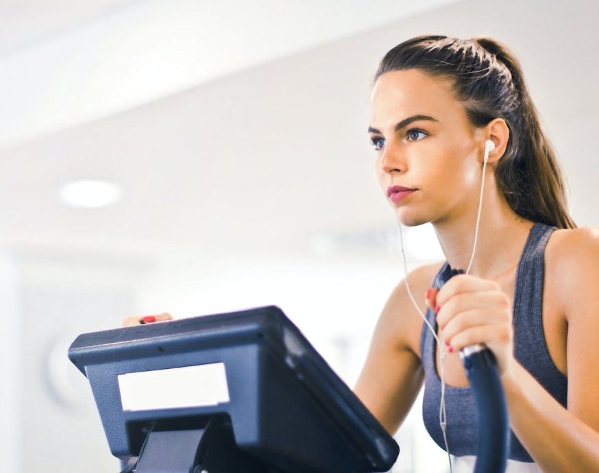 Woman training on a step machine in a gym